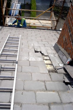 Fixing Roof with scaffolding - D. Coakley Ltd. Roof Repairs, Dublin, Ireland